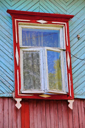 vertical orientation: Closed shutters of old rustic window on rural wooden house wall. Vertical orientation Stock Photo