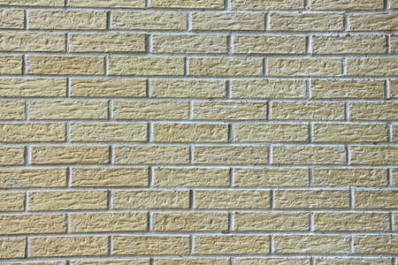 structured: Wall of structured decorative light bricks as background or texture. Horizontal orientation