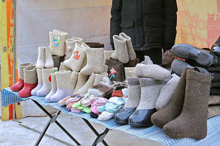 valenki: Variety of traditional russian felt boots on counter, February 22, 2015, Tula, Russia