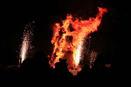 bugaboo: Traditional burning of Maslenitsa Scarecrow on seeing Russian winter on last day of Shrovetide in dark evening. Burning effigy on black background