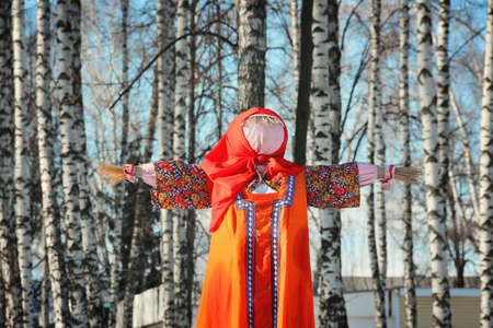 Traditional Maslenitsa Scarecrow on seeing Russian winter on last day of Shrovetide in winter sunny day