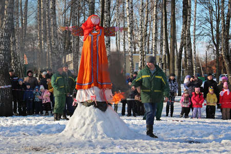 Traditional burning of Maslenitsa Scarecrow on seeing Russian winter on last day of Shrovetide. Worker of fire safety begins ignition of stuffed, March 3, 2016, Tula, Russia