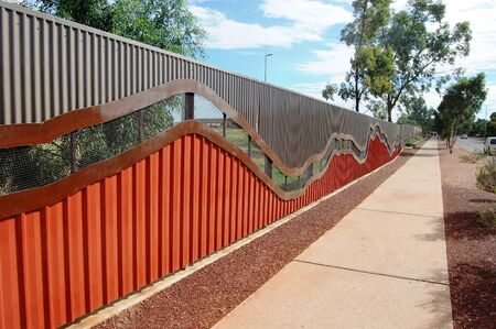 Fence and walking path, Alice Springs, Northern Territory, Australia Stock Photo