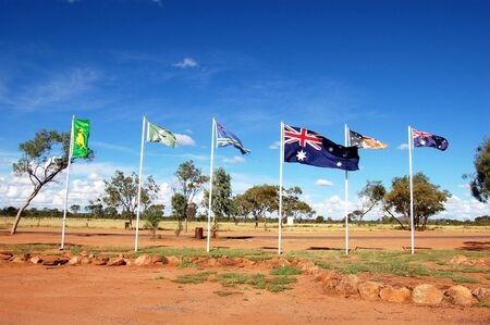 Australian and aboriginal flags in outback, Northern Territory, Australia photo