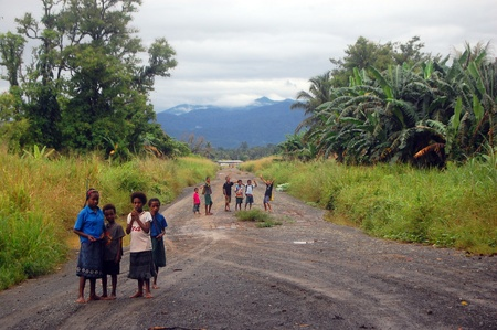 Children on the road, near the village in Papua New Guinea Editorial