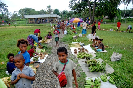 People on market at the village in Papua New Guinea