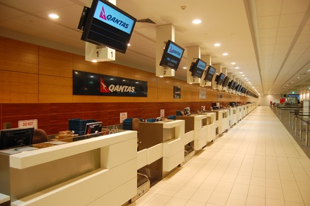 Empty Cairns Airport, Qantas check-in desk, Australia