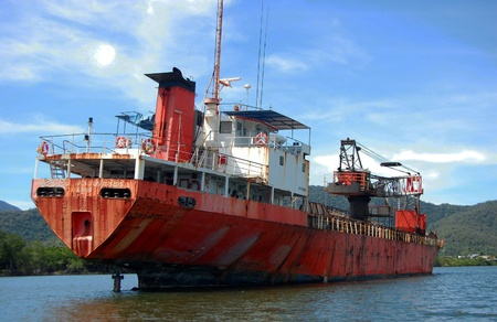 keel: Abandoned red ship on the river nearby Cairns, Australia Editorial