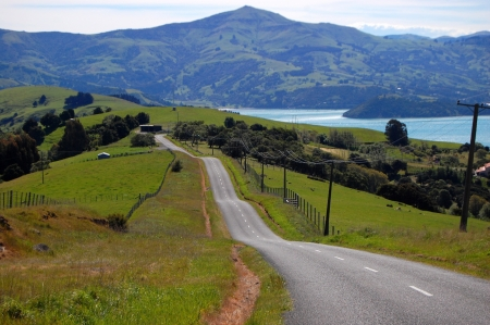new direction: Hilly road , near Akaroa, Banks Peninsula, New Zealand