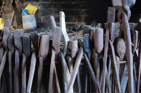 blacksmith shop: Old metal tools at forge, New Zealand Stock Photo