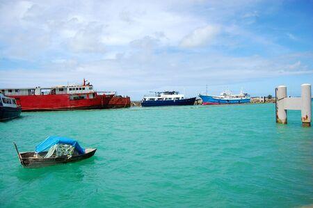 Boat and ships at port, South Pacific, Tonga