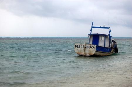 Boat near coast, South Pacific, Kingdom of Tonga