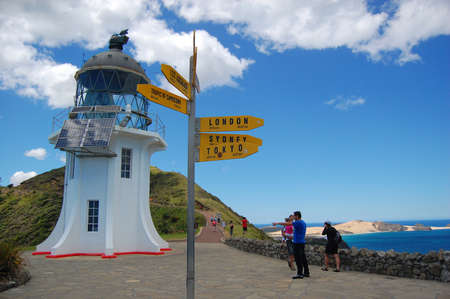 reinga: Yellow tourist sign at near old vintage lighthouse, Cape Reinga, New Zealand