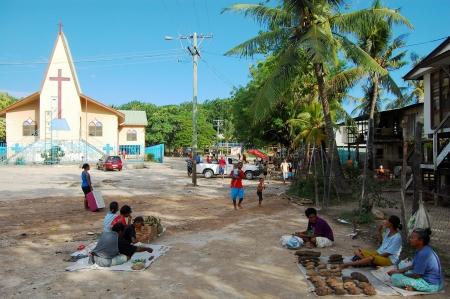 Village market near christian church building, Papua New Guinea