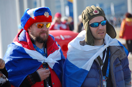 olympic symbol: Russian spectators with flags at XXII Winter Olympic Games Sochi 2014, Russia, 15 02 2014