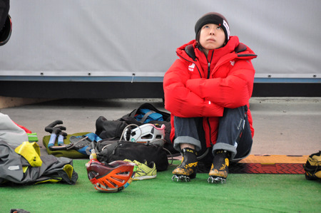 ice axe: Asian woman looks up having rest ice climbing, Russia