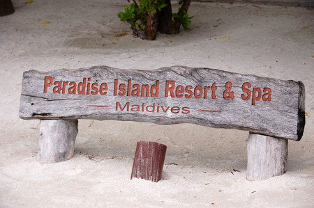 name plate: Paradise Island Resort timber name plate at sand beach, Maldives