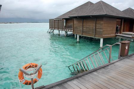 flotation: Live safer near timber pier and building at Maldives