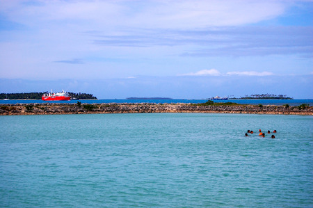 south pacific: People swimming near port, Tonga, South Pacific Stock Photo