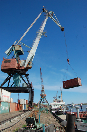 dockside: Dockside cargo crane with container at river port, Kolyma, Russia