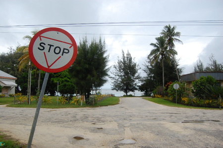 caution sign: Stop sign at road junction Tonga, Lifuka Island