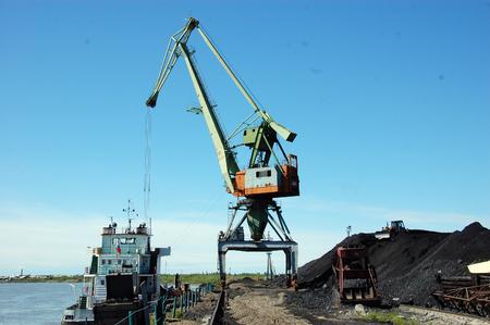 dockside: Dockside cargo crane at river port, Kolyma, Russia outback