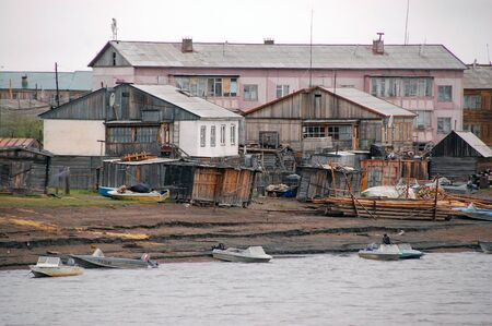 the outback: Boats at Kolyma river coast in outback town, Yakutia, Russia Stock Photo