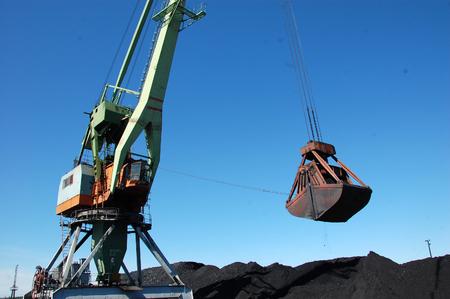 dockside: Dockside cargo crane loading coal at Kolyma river port, Zyryanka, Yakutia, Russia