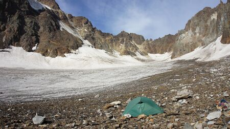 bivouac: Green tent at glacier Greater Caucasus Mountain Range, North Osetia, Russia