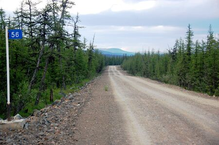 kilometer: Kilometer post at taiga gravel road, Chukotka, Russia Stock Photo