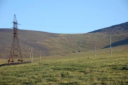 Electric cable line at tundra near Pevek town, Chukotka, Russia
