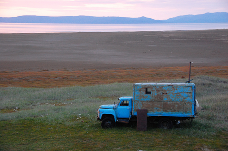 adapted: Old broken truck adapted as shed at tundra island, Routan Island, Chikotka, Russia