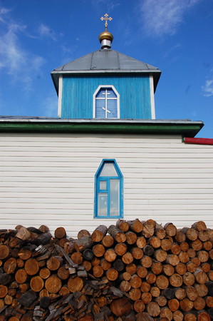 Woodpile at christian church building, Pevek town, Chukotka, Russia