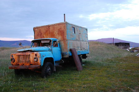 Abandoned broken mud hut at arctic summer tundra, Routan Island, Chukotka, Russia