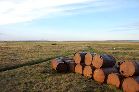 Abandoned oil drums at tundra, Chenkul Island, Chukotka, Russia