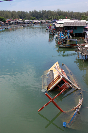 Abandoned sinked boat at river, Southern Thailand