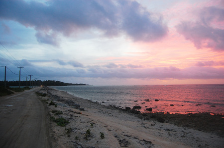 south pacific: Gravel road between islands evening twilight, Haapai Islands, Polynesia, South Pacific, Tonga Stock Photo