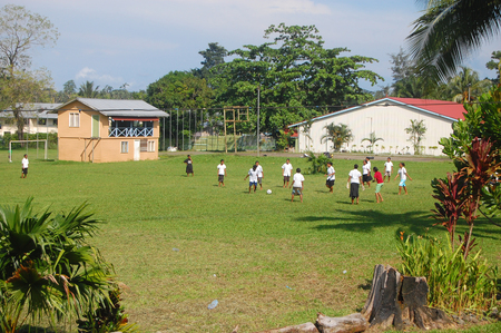 Women play soccer at high school campus, Alotau town, Milne Bay Province, Papua New  Guinea