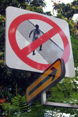 compulsory: Prohibiting pedestrian road sign with arrow symbol, Singapore Stock Photo