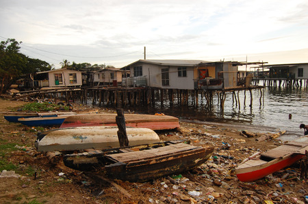 Boats with garbage at sea village coast, Papua New Guinea Stock Photo