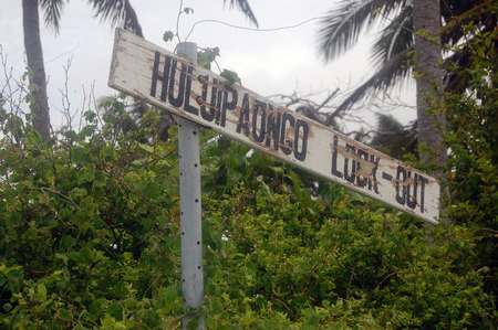 Old abandoned timber tourist sign, Haapai Island, Polynesia, South Pacific, Tonga