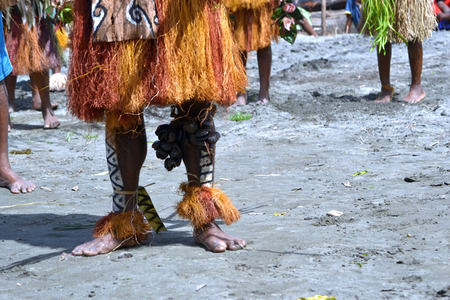 Traditional tribal dance at mask festival. 7th Gulf Mask Festival, Toare Village, Gulf Province, Papua New Guinea on June 19, 2011 Editorial