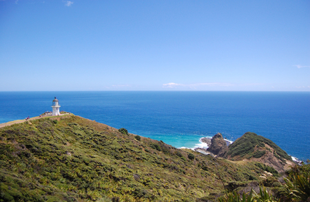 Cape Reinga lighthouse hilly sea coast, Northland, North Island, New Zealand