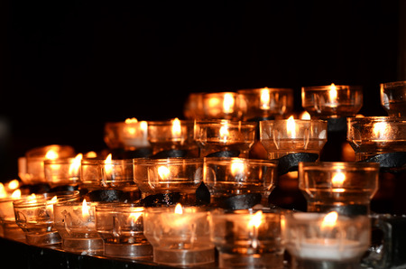 longer: Candles lit for loved ones no longer with us Stock Photo