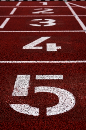 Numbers printed on a running track photo