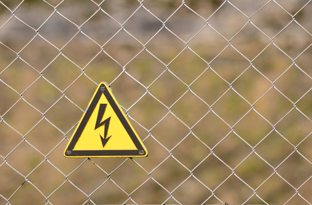 Electrocution sign on a fence photo