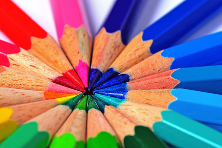 A macro image of colooured pencils arranged in a spectrum