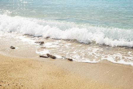 deniz: Image of gentle waves on a sea front with rocks in the foreground, the image was taken in Olu Deniz, a popular european holiday destination