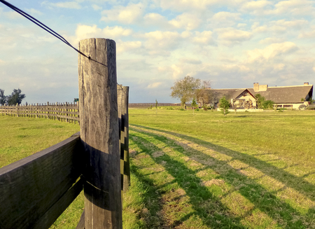 america countryside: A fence and a House in the Countryside in South America, Uruguay