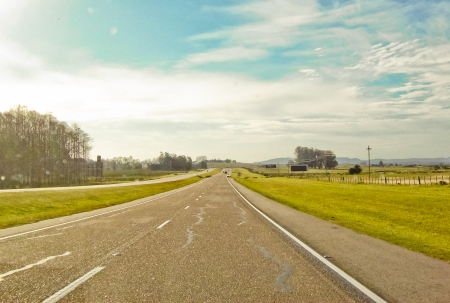 Empty roadway in the meadow  Stock Photo